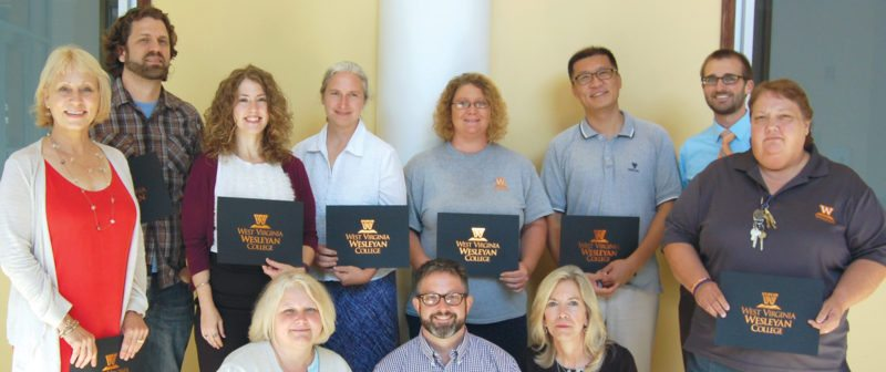 aSubmitted photos  West Virginia Wesleyan College recently recognized employees for their years of service to the college. Recognized for 10 years of service are, from left, first row, standing, Susan Aloi, kneeling, Kim Haney, Thomas Schoffler and Allison Hull, standing: Lee Ann Tomey; and second row: Micah Snyder, Susan Harsh, Teresa Buckner, Amanda Hamrick, Mu Hu and Brett Miller.