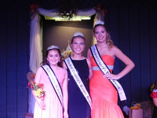 The Inter-Mountain photo by Bayli Helmick Winners of the 2017 Tucker County Fair pageants pose for photos on Tuesday. The winner of the Junior Queen competition, Laney Burns; winner of the Queen Daphne competition Mary Carr; and winner of the Teen Daphne competition, Calista Eye received crowns and sashes during the pageant. The Tucker County fair events began Tuesday and will continue through the week.