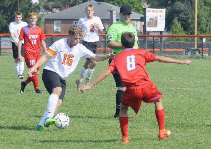 The Inter-Mountain photo by Tony Baisi Elkins High School senior Ethan Sutton controls the ball during the Tigers' 1-1 tie match against Wheeling Park on Saturday.