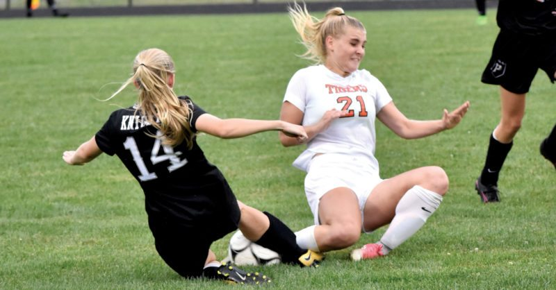 The Inter-Mountain photo by Logan Comer Elkins senior Rachel Phillips collides with a Preston County player while going for the ball Thursday.