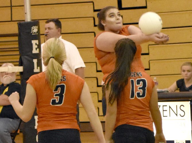 The Inter-Mountain photo by Logan Comer An Elkins High School Lady Tigers volleyball player sets the ball Thursday against Preston County.