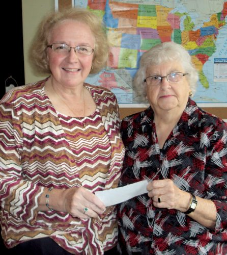 Submitted photo Deloris Wilfong, right, president of the Elkins High School Alumni Association, presents a donation to Penny Crawford, secretary of the Randolph County Hall of Fame.
