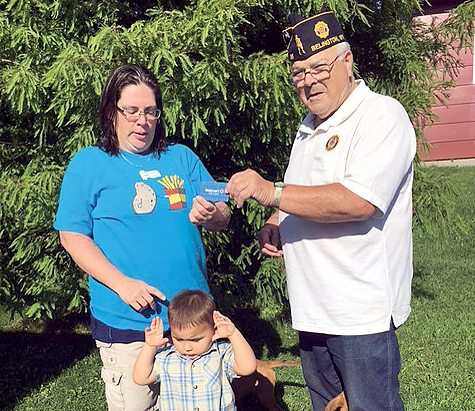 Submitted photo The contest winners of the Belington American Legion Post 96 are Darren Smith of Maryland, K. Arbogast of Belington and Clifford Poe of Belington. Pictured are Commander Ralph Baumgardner and K. Arbogast with her nephew.