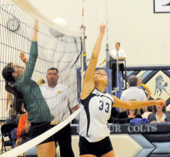 The Inter-Mountain photo by Tony Baisi Philip Barbour senior Maddi Carpenter defends the net for PB Wednesday at the Colts' Corral. Carpenter racked up a total of 58 assists for the Colts during a Big 10 Conference quad-match hosted by PBHS.