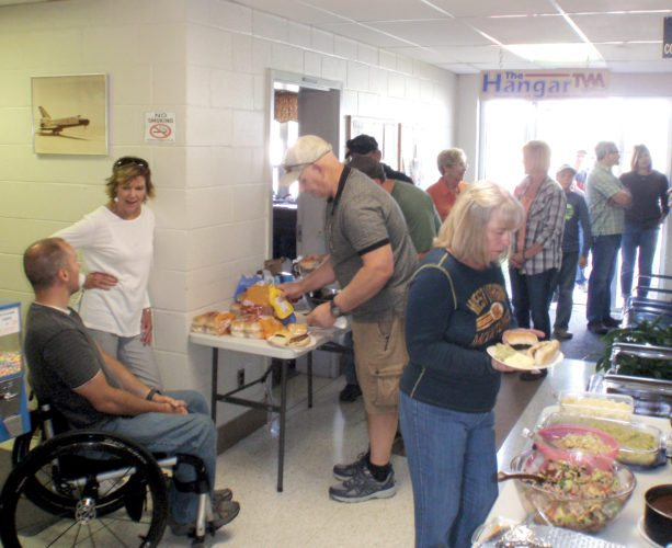 Submitted photos A cook-out picnic, above, is held at the Elkins-Randolph County airport recently and was attended by many members of the local airport community