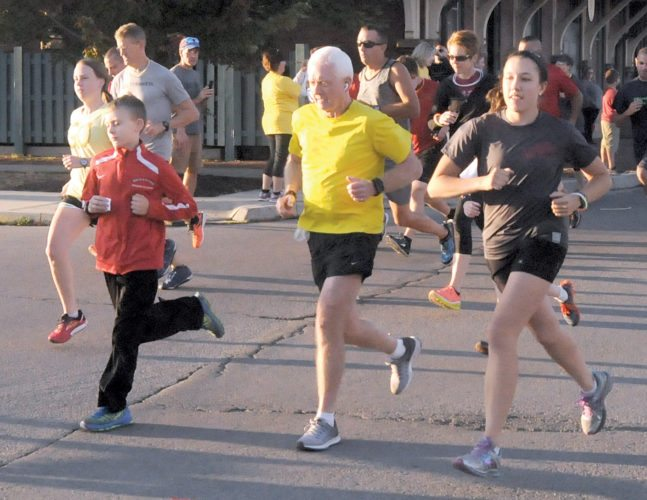 The Inter-Mountain photo by Brad Johnson Participants begin the Sunset Chase 5K Fun Run in front of the Elkins Depot Saturday evening. The course took them through the streets of Elkins before returning to the Depot to cross the finish line. Results from the event will be published in a future edition of The Inter-Mountain.