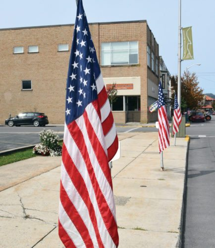 The Inter-Mountain photos by Tim MacVean American flags adorn many downtown streets in Elkins Monday in remembrance of those who lost their lives during the Sept. 11, 2001 terrorist attacks.