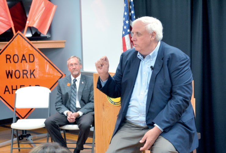 The Inter-Mountain photo by Tim MacVean Gov. Jim Justice speaks to area residents and elected officials about the upcoming 'Road to Prosperity' bond referendum – slated for a Nov. 7 special election – Monday afternoon at the West Virginia Wood Technology Institute in Elkins. Tom Smith, secretary of transportation for the West Virginia Division of Transportation, is pictured at left.