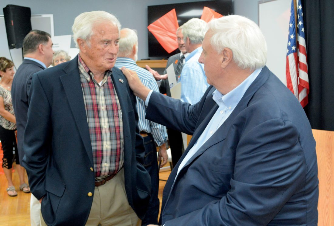 William 'Bill' Hartman, delegate for the 43rd district, left, exchanges pleasantries with Gov. Jim Justice following a 'Roads to Prosperity' bond referendum town hall meeting Monday afternoon at the West Virginia Wood Technology Institute in Elkins.