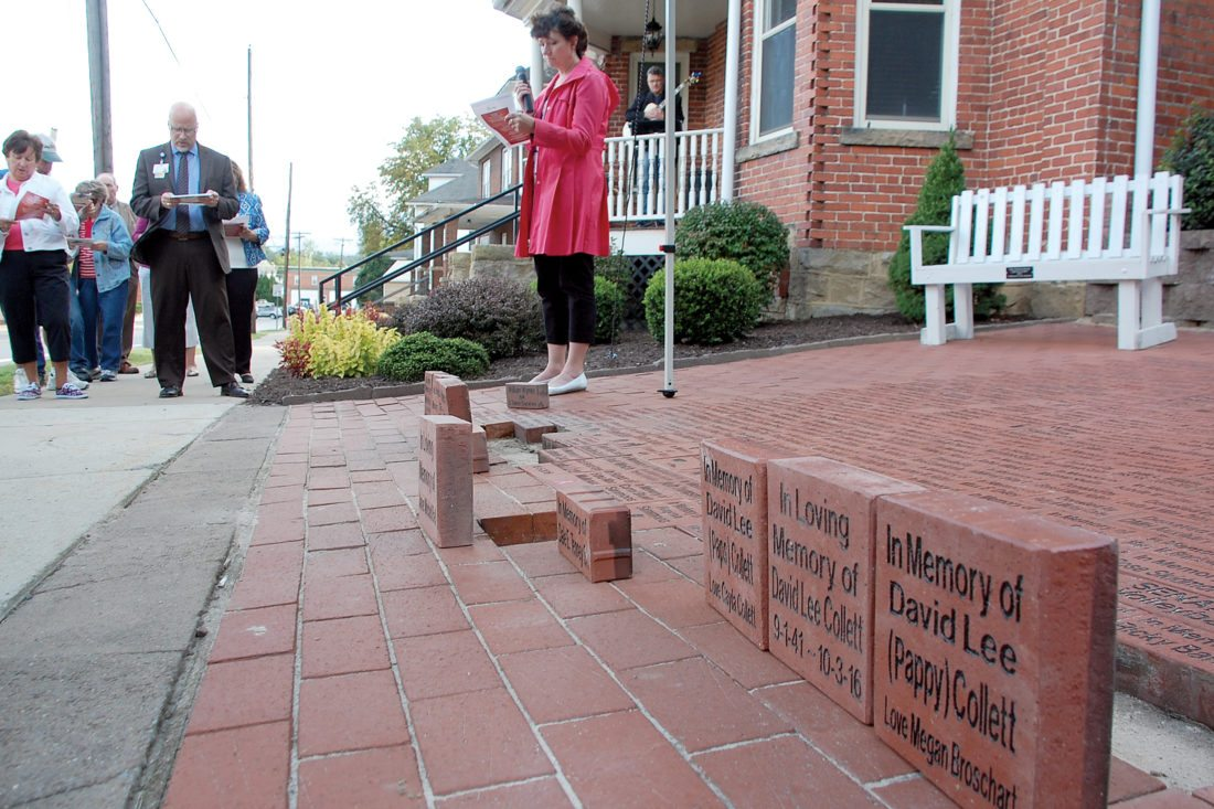 The Inter-Mountain photo by Beth Henry-Vance Community members and Davis Medical Center representatives take part in Tuesday's 'Blessing of the Bricks' ceremony at the Davis House in Elkins. Bricks are dedicated in memory of loved ones, in honor of someone special or as a way to commemorate a special event, such as a wedding or anniversary.