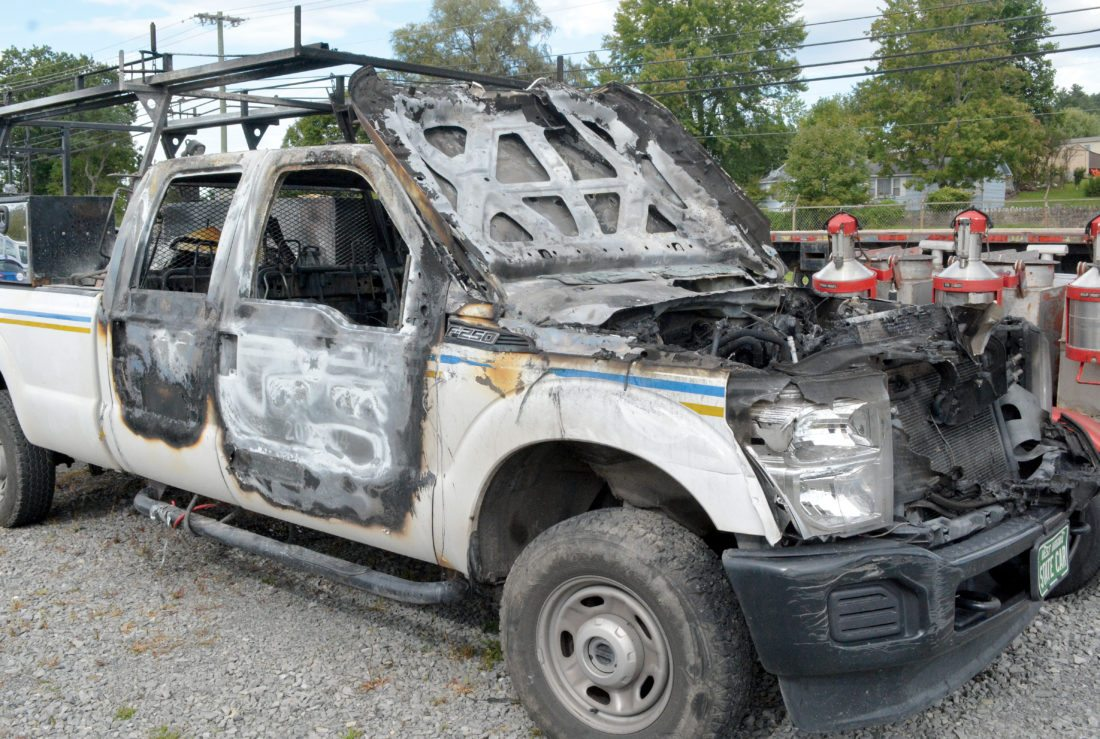 The Inter-Mountain photos by Tim MacVean A Department of Highways 2014 Ford F-250 crew cab pickup truck sustained heavy damage after being stolen Monday night from the DOH District 8 facility, located just outside Elkins on U.S. 219, and set ablaze.