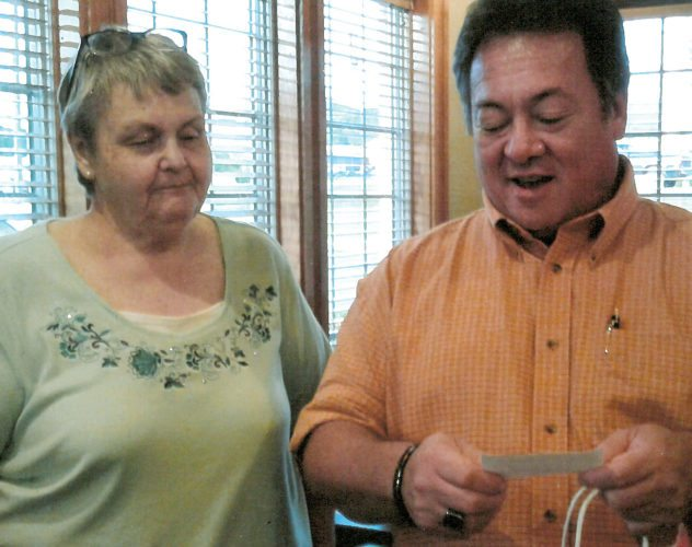 Submitted photo Bob Evan's Restaurant assistant manager Dave Elmore draws a ticket for the raffle at the Tygart Valley Ladies Shrine Club fundraiser.