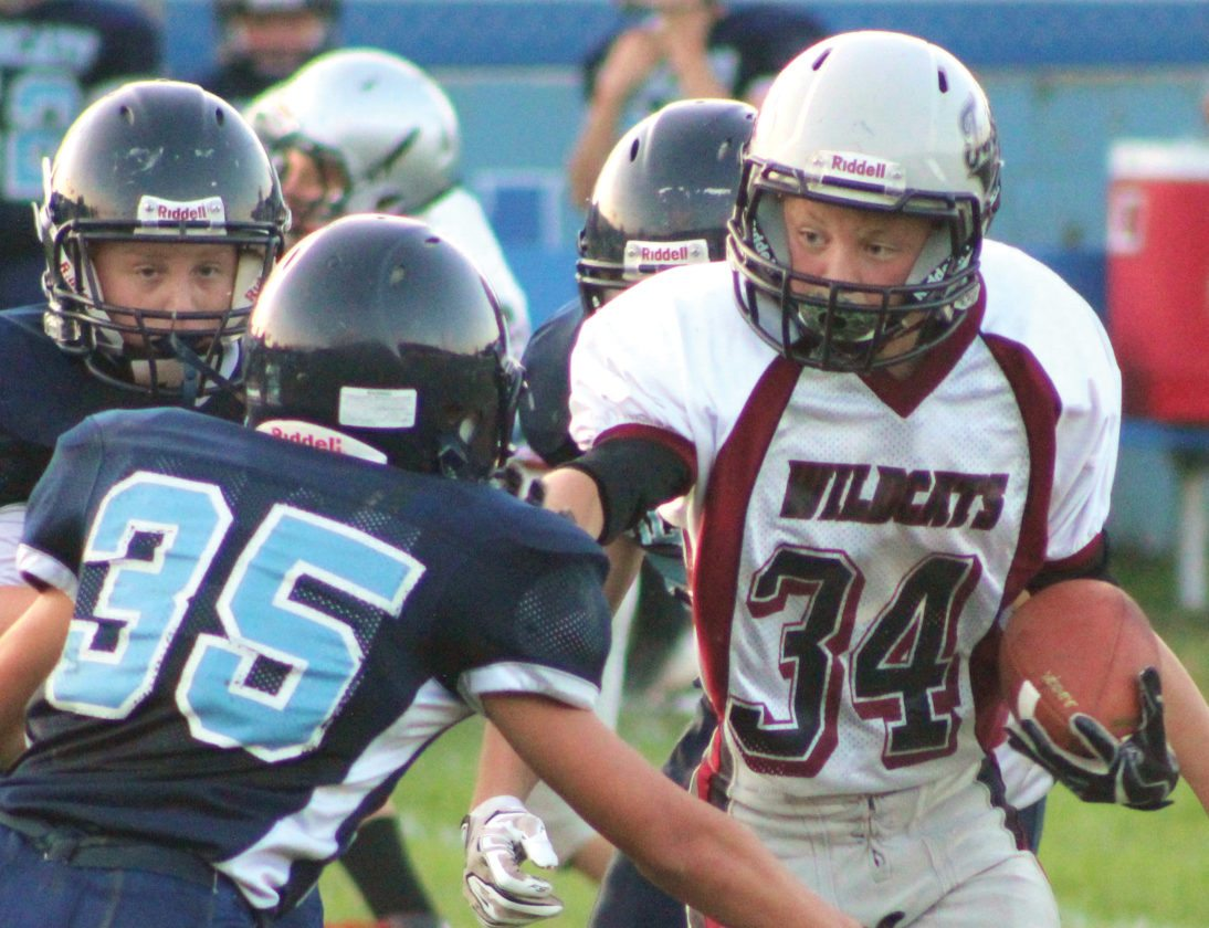 The Inter-Mountain photo by Brittany Hardy The Tucker Valley Middle football team earned their first win of the season on the road at Pendleton County Wednesday night, 14-6. Above, Rory Nestor looks to gain yardage during the contest.