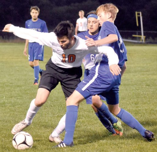 The Inter-Mountain photo by Logan Comer Elkins High's Austin Storey, No. 10, struggles with Fairmont Senior players for control of the ball Thursday.