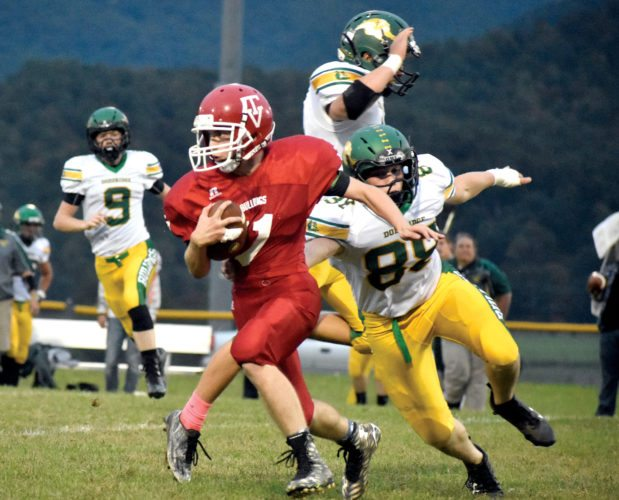 The Inter-Mountain photo by Logan Comer Tygarts Valley wide receiver Dalton Grimes runs with the ball through the Doddridge County defense Friday.