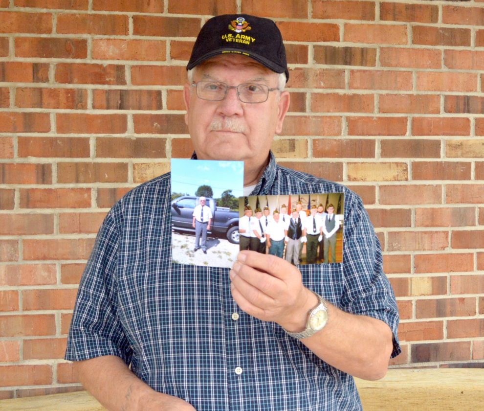 The Inter-Mountain photo by Tim MacVean American Legion Post 29 Chaplain Arley Simmons, who served as a sergeant E-5 in the U.S. Army from 1958 through 1961, displays photos of himself in his American Legion attire and with the American Legion Post 29 Honor Guard.