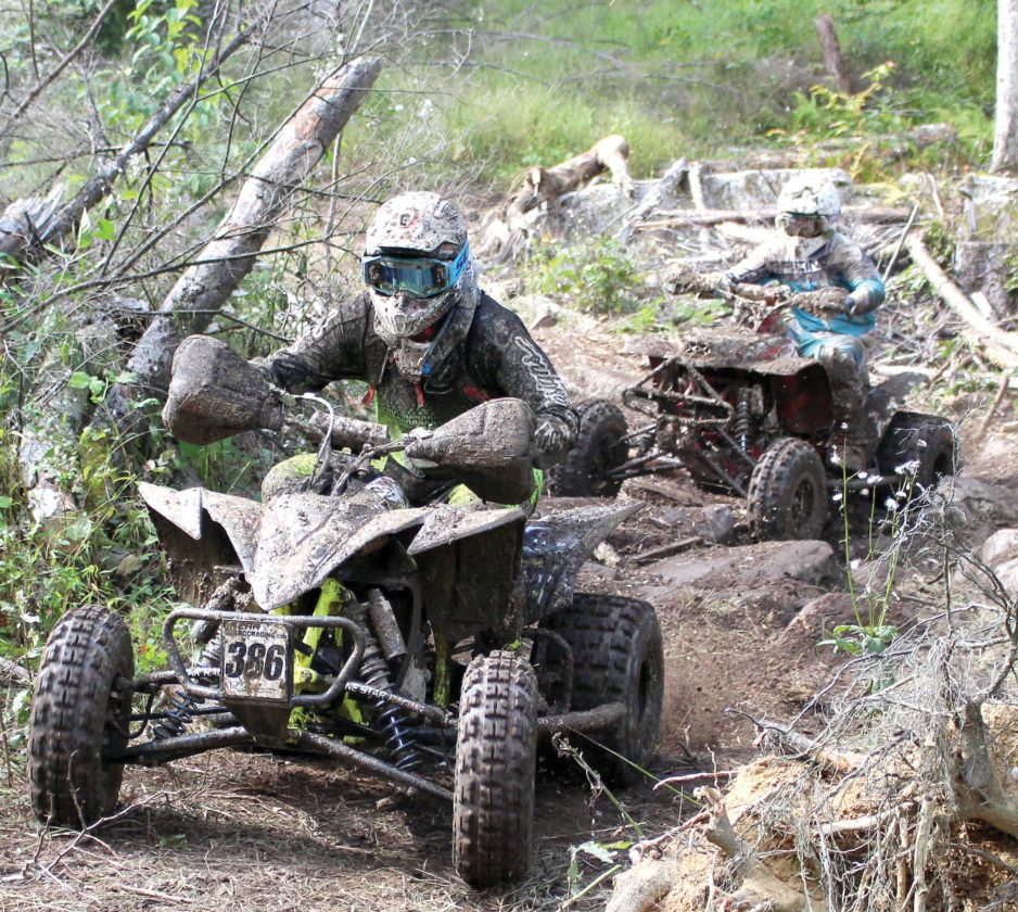 The Inter-Mountain photo by Brooke Binns Riders compete in the Mountain State Forest Festival Motorcycle and ATV Race in Jimtown Sunday.