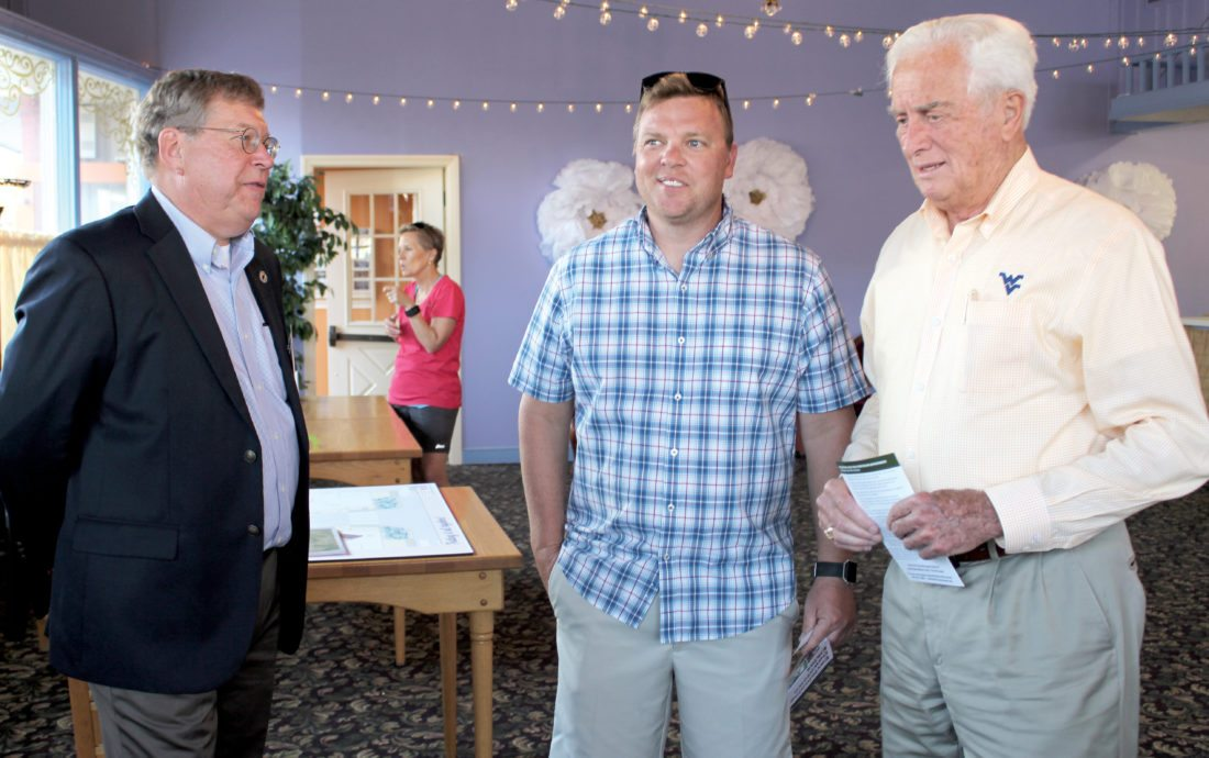 The Inter-Mountain photo by Brooke Binns Dozens came out to the 'Envisioning Downtown Elkins' open house on Tuesday. Pictured from left are David Cutlip, Sid Gillispie and Bill Hartman.