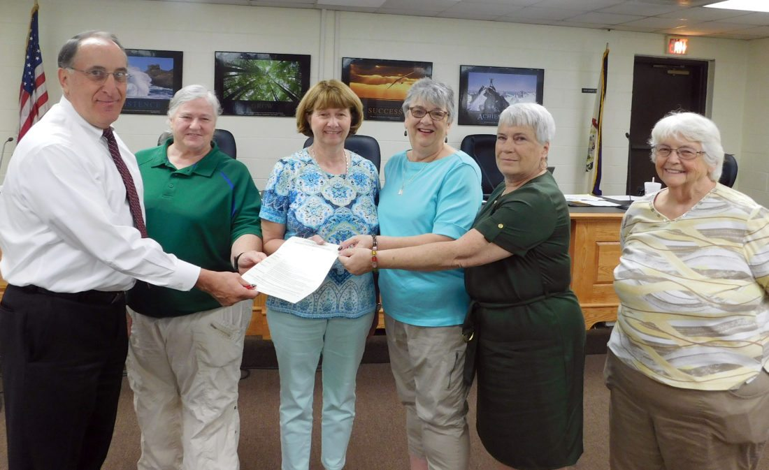 The Inter-Mountain photo by Beth Henry-Vance The superintendent of the Randolph County Board of Education makes a proclamation Tuesday to recognize the week of Sept. 25 to 29 as West Virginia Association of Retired School Employees Week. Shown here during the meeting, from left, are Superintendent of Schools Gabriel J. 'Gabe' Devono; Luanna Moore, local membership chairperson; Rosemary Markley, local secretary; Lorrayne Corley, local budget chairperson; Donna Auvil, local president of the Randolph County ARSE and the Randolph County Board of Education; and Judy Harris, local vice president.