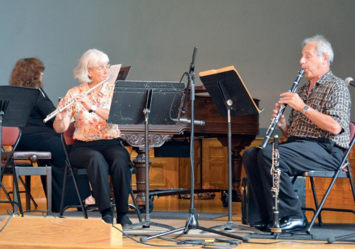 The Inter-Mountain photo by Tim MacVean Clarinetist Richard Rubock and Friends played to a capacity crowd Wednesday afternoon as part of the Brown Bag Concert Series at the Arts Center. From left are pianist Donna Huffman, flautist Katy McClane and Rubock. Brown Bag concerts are offered at noon on the third Wednesday of each month.