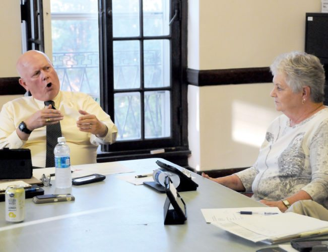 The Inter-Mountain photo by Brad Johnson Elkins City Councilman Charles Friddle, at left, makes a point during a discussion with Councilwoman Linda Vest, right, during Thursday's Revenue Committee meeting.