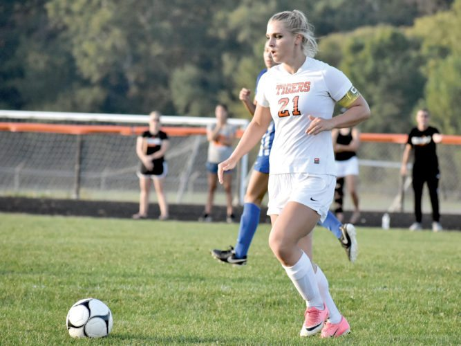 The Inter-Mountain photos by Logan Comer Elkins senior Rachel Phillips surveys the field as she controls the ball during Tuesday's contest against Morgantown