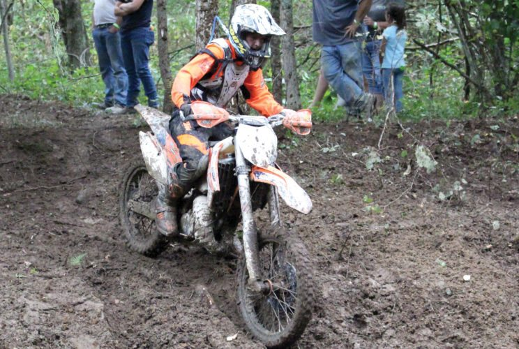 The Inter-Mountain photo by Brooke Binns An adult ATV rider starts into a mud pit in Jimtown at the Mountain State Forest Festival Motorcycle and ATV Race on Sunday.