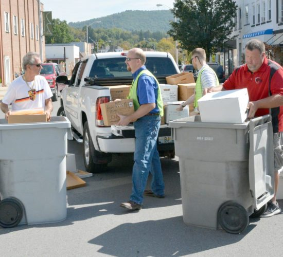 "The Inter-Mountain photo by Tim MacVean Citizens Bank of West Virginia personnel help unload documents from a truck in preparation for them to be shredded by RMS Shredding, of Martinsburg, during a 'Shredding Party' Friday afternoon at the bank facility. Pictured, from left, are Elkins resident Bill Johnson; Nathaniel Bonnell, Citizens Bank of West Virginia president and CEO; Dusty Casto, Citizens Bank of West Virginia IT officer; and Jim Kranenberg, RMS Shredding shred truck operator. Individuals were permitted to bring paper documents and hard drives to be shredded. ""For a first time event, we were very happy with the results,"" said Kathy Leombruno, senior vice president and marketing officer for Citizens. ""Approximately 100 people brought boxes of documents to be shredded and hard drives to be destroyed. Many participants exclaimed how thankful they were that Citizens provided free community shredding and hoped we continue to make this an annual event. Judging from its success and the appreciation from the community, I would venture to say this won't be the last Fall Shred Fest."""