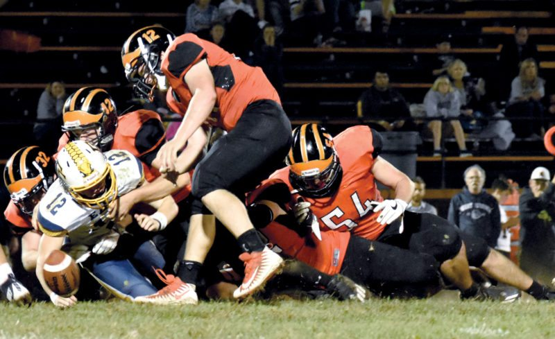 The Inter-Mountain photo by Logan Comer The swarming Elkins High defense forces a fumble Friday night against East Fairmont.