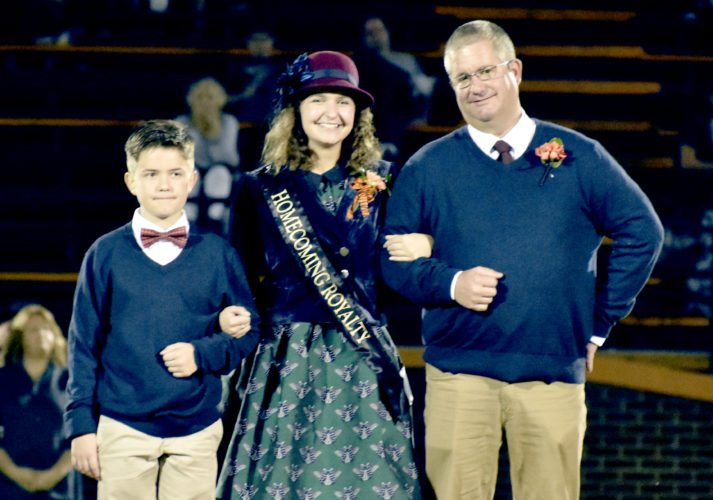 The Inter-Mountain photo by Logan Comer Madison Rose Bowers was named Elkins High School homecoming queen Friday night and crowned at halftime of the Elkins Tigers game against East Fairmont. Bowers is the daughter of Todd and Nicki Bowers, and was escorted by her father, Todd Bowers, and her brother, Nick Bowers.