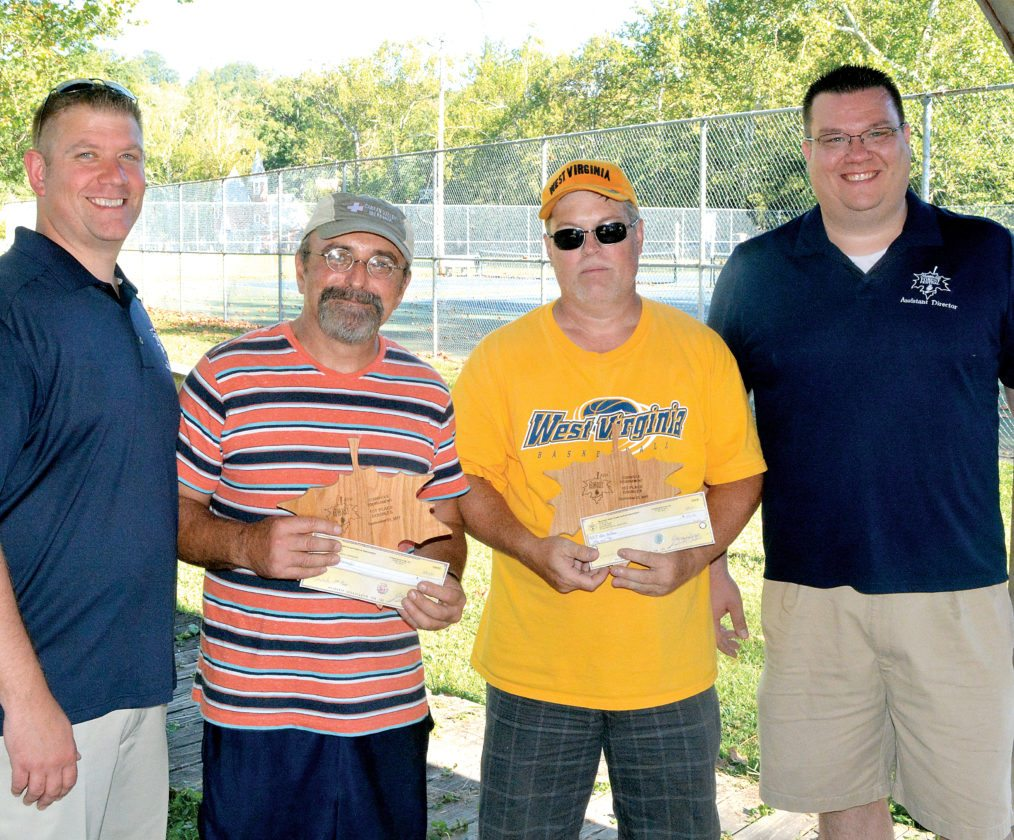 Alan Huffman and Micky Sponaugle, known as 'Dem Farm Boyz,' took home top honors Saturday in the 2017 Mountain State Forest Festival cornhole tournament. The first place winners received a $100 prize. Seventeen teams participated in the double-elimination event and all participants received coupons from Sheetz in Elkins, which also provided the cornhole boards. Pictured, from left, are MSFF Director General Chad Shoemaker, Sponaugle, Huffman and Assistant Director Robbie Morris.