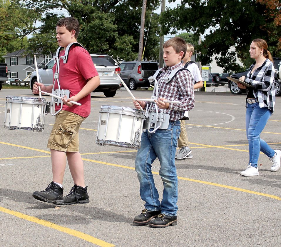 The Inter-Mountain photo by Brooke Binns Members of the Elkins Middle School marching band practice Monday in the parking lot of the Phil Gainer Community Center, preparing for an upcoming Mountain State Forest Festival parade.