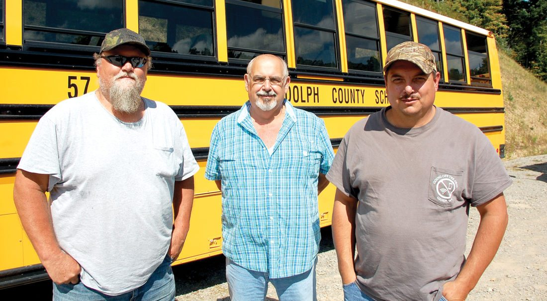 The Inter-Mountain photo by Beth Henry-Vance From left, Steve 'Haystack' Collins, Randy Sprinkel and James Harper are three Randolph County bus drivers. They are shown here recently at Davis & Elkins College after bringing local high school students to a college fair as part of a field trip.
