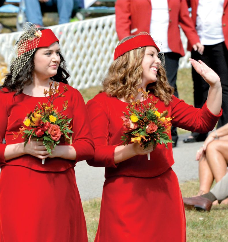 81st Mountain State Forest Festival princess Karli Renee Hopwood, right, waves to her family while princess Janine Rae Beer looks on. Their dress color is 'royal ruby.'