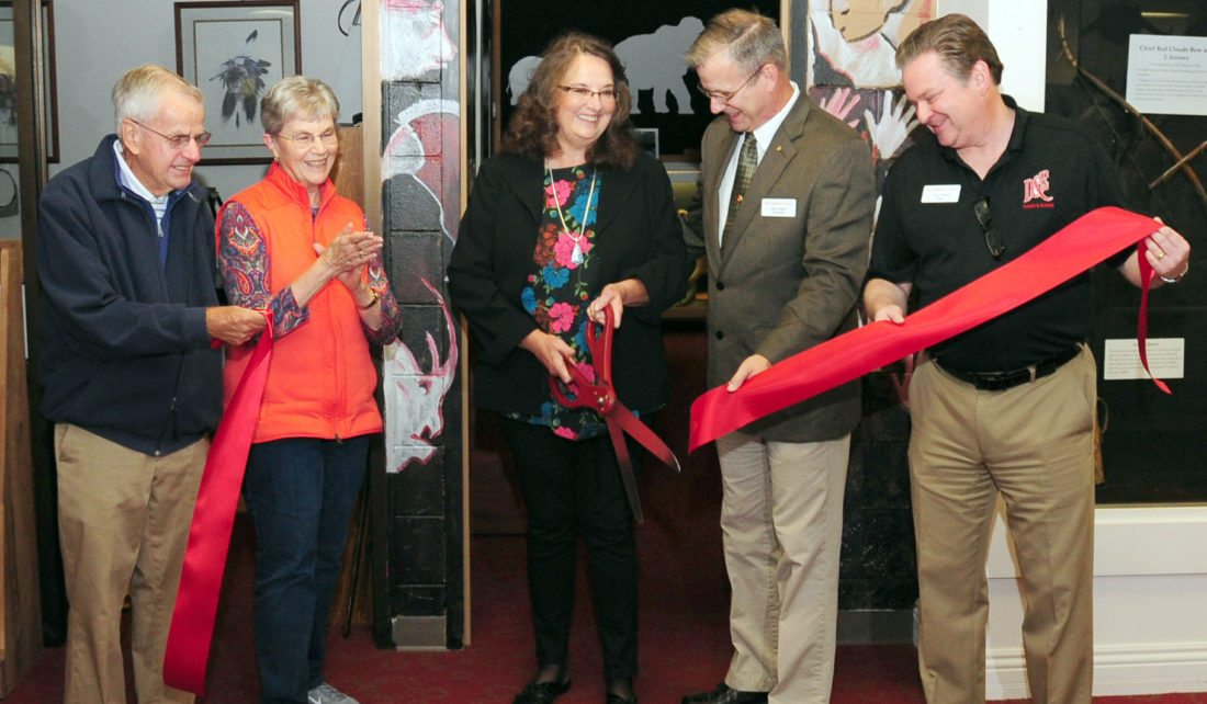 Submitted photo Cutting the ribbon to officially dedicate the Reckling Collection in The Stirrup Gallery are, from left, Chair Emeriti Paul Stirrup, Karen Stirrup, Shelia Marshall, Coordinator of Special Collections Mark Lanham and Davis & Elkins College President Chris A. Wood.