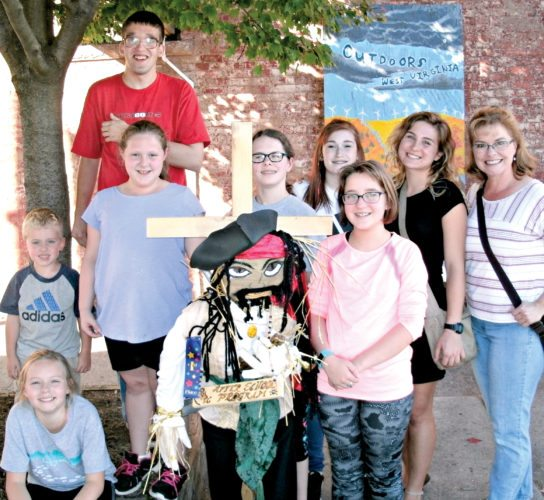 Submitted photos Elkins Main Street has announced winners of the Youth Division competition in the 2017 Scarecrow Festival. Cash awards of $100, $75  and $50 are presented to the winning youth groups, Davis Memorial Presbyterian Church After School Program, the Elkins Bengals Cheerleaders and Elkins Mountain Schools. First place went to 'Captain Jack Sparrow,' by the DMPC After School Program, shown above.