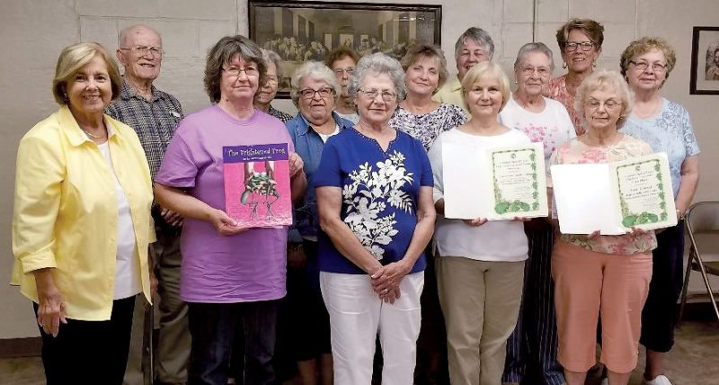 Submitted photos Members of the Fred Brooks Garden Club display the National Garden Club Award for the Frightened Frog Project