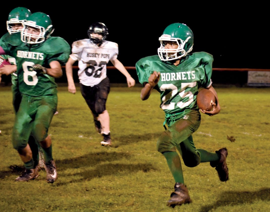 The Inter-Mountain photos by Logan Comer Elkins Middle's Xavier Sweezy makes a dash for the end zone on a touchdown run Wednesday evening.