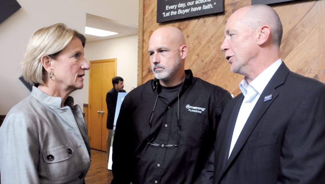 The Inter-Mountain photos by Beth Henry-Vance U.S. Sen. Shelley Moore Capito, R-W.Va., left, speaks at Armstrong Flooring's plant in Beverly Wednesday with Blaine Emery, center, plant manager, and Dominic Rice, Armstrong's senior vice president of global operations and manufacturing.