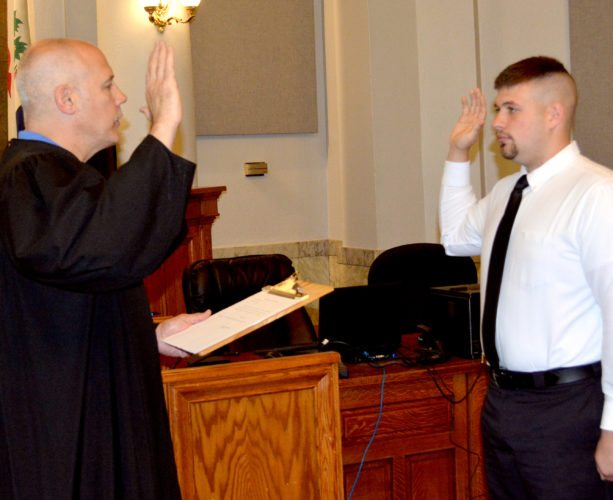 The Inter-Mountain photos by Tim MacVean Bryan Roy, right, is sworn in as a Randolph County Sheriff's Deputy by Circuit Judge David Wilmoth Thursday morning at the Randolph County Circuit Courtroom. Roy is also a member of the United State Marine Corps and has previously worked as a firefighter and EMT.