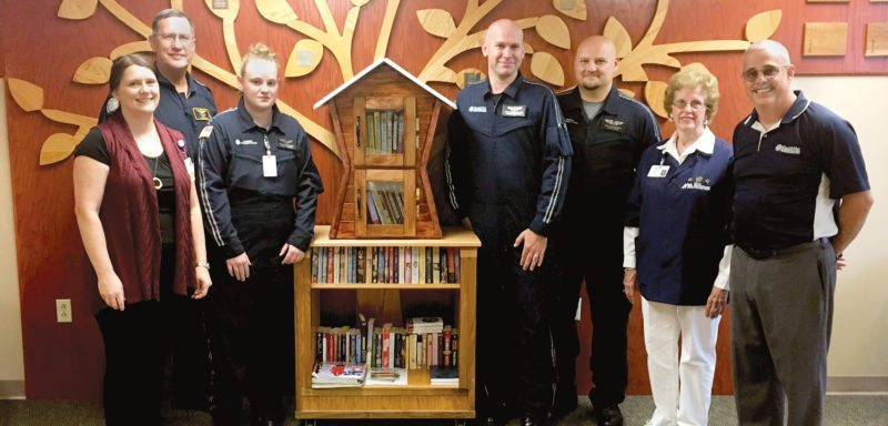 Submitted photo Davis Medical Center and HealthNet Aeromedical Services representatives display the new Little Free Library located in DMC's visitor entrance. The library offers free books to the community. From left are Valerie Bright, Gary Ryder, Sara Rogers, Carl McCormick, Mah Rose, Betty Patton and Dennis Wilson.