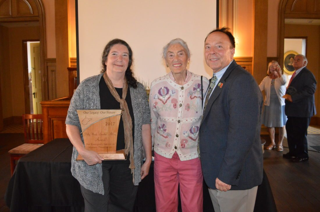 Photo by Drew Parker The West Virginia State Historic Preservation Office presents the 2017 'Our Legacy, Our Future' historic preservation awards Sunday at West Virginia Independence Hall in Wheeling. Phyllis Baxter of Elkins received the Betty Woods 'Snookie' Nutting Award for exemplary service to historic preservation. Baxter, left, is pictured with Nutting and Randall Reid-Smith, commissioner of the West Virginia Division of Culture and History. The award is named in Nutting's honor for her longtime commitment to historic preservation in Wheeling.