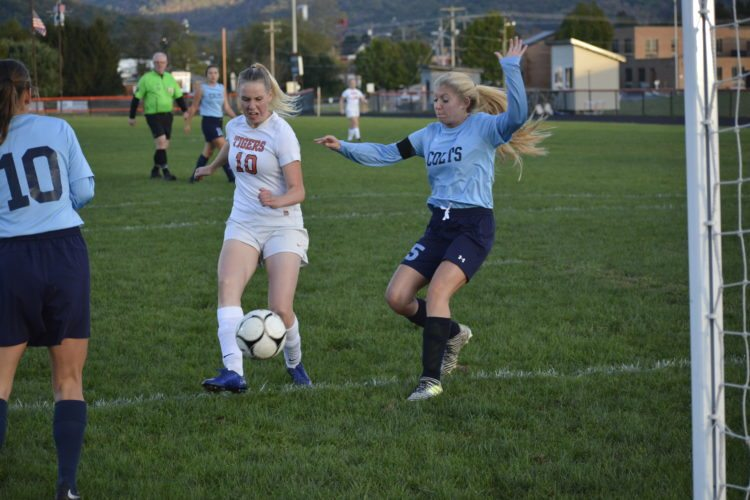 The Inter-Mountain photos by Logan Comer Elkins High School's Maiju Hyvarinen, No. 10, scores one of her three goals Monday. Her hat trick helped the Lady Tigers down Philip Barbour in sectional tournament action.