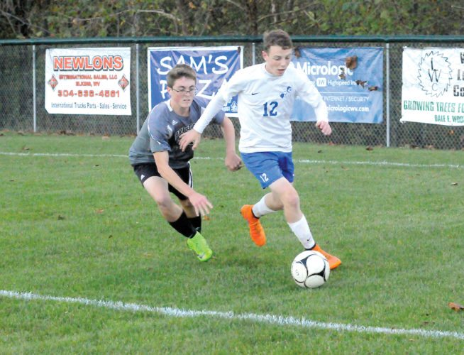 The Inter-Mountain photos by Tony Baisi Buckhannon-Upshur senior Christopher Hollen drives the ball into Preston territory Tuesday as the Bucs work on a 3-1 win in order to advance to the Class AAA Region I Section 2 championship game on Thursday.