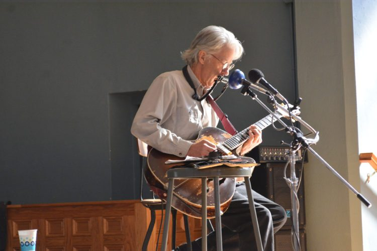 The Inter-Mountain photo by Tim MacVean Don Olson sings, plays harmonica and strums his guitar as he performs as part of the Brown Bag Concert Series Wednesday afternoon at The Arts Center in Elkins. Brown Bag concerts take place at noon, the third Wednesday of each month.