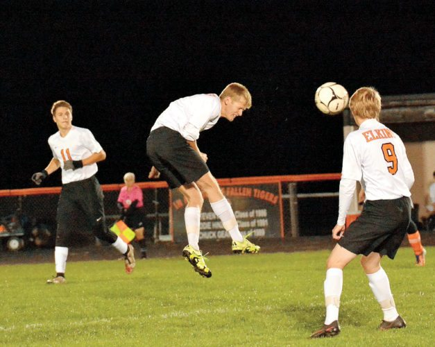The Inter-Mountain photos by Logan Comer An Elkins player heads the ball during the Tigers' sectional victory over South Harrison Thursday evening.