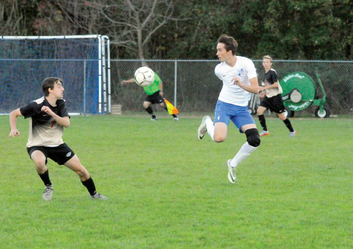 The Inter-Mountain photo by Tony Baisi B-UHSsenior Trevor Short back-heels the ball to help push up into attacking territory Thursday at Ted Crites Alumni Field.