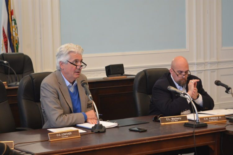The Inter-Mountain photo by Tim MacVean Home Rule Board Cabinet Secretary Dave Hardy, left, and board member Chris Fletcher listen to a presentation from Morgantown City Planner Paul Brake Thursday morning during a West Virginia Home Rule Board meeting at Elkins City Hall.