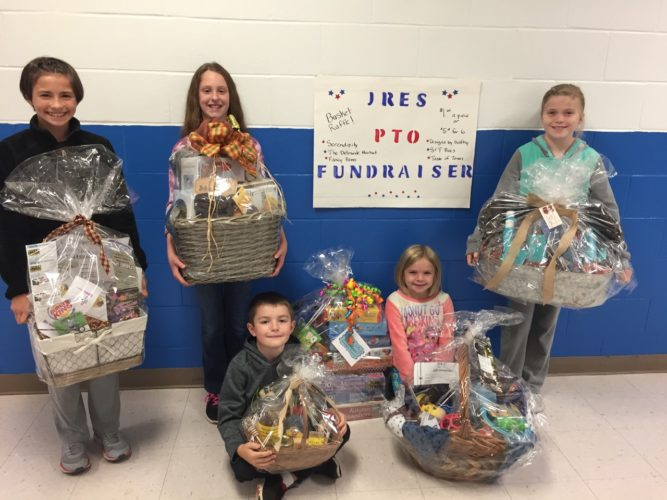 Submitted photo Jennings Randolph Elementary students display baskets that will be raffled off Sunday at the school, where a cake walk will also be offered.