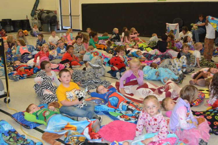 The Inter-Mountain photo by Tim MacVean Third Ward Elementary School students get cozy in their pajamas as they prepare to watch the movie 'Captain Underpants' Friday afternoon as part of a Positive Behavior Support program at the school. Each nine weeks, students who have good attendance, display good behavior, complete their homework, help other students and are responsible are rewarded with an activity.